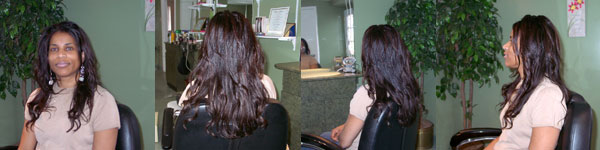 Maureen, the head stylist, shows her long natural healthy hair.